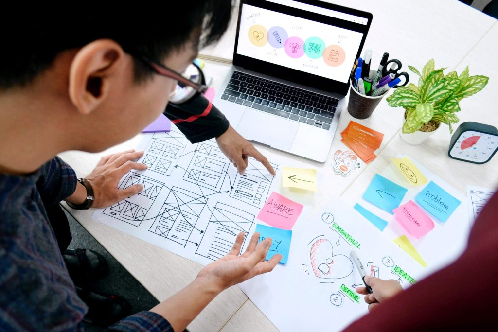 UX Designers create the end user's experience with the website, delivering different scenarios and steps of interacting with the product.